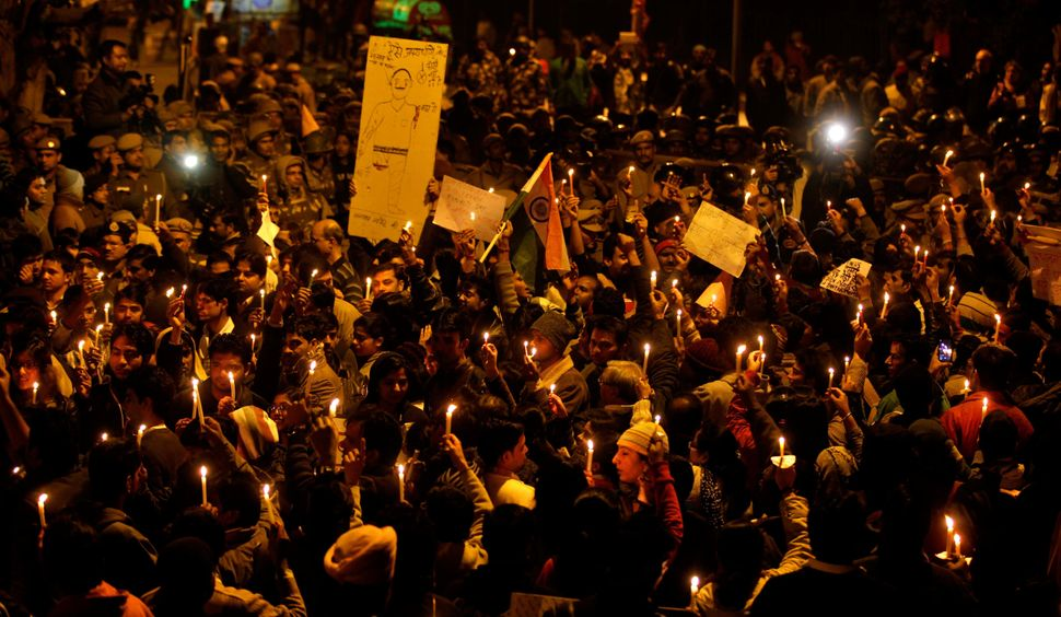 Protesters in New Delhi march silently on December 2012, mourning the death of the 23-year-old student who was gang raped on