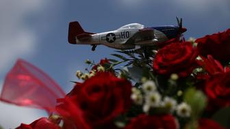 MIAMI, FL - JULY 21:  A replica of a P-51 Mustang World War II fighter plane is seen during the funeral of retired Air Force Lt. Col. Eldridge Williams at the Sweet Home Missionary Baptist Church on July 21, 2015 in Miami, Florida. Lt. Col. Williams passed away at the age of 97 on July 2nd; he was one of the legendary Tuskegee Airmen, a group of U.S. Air Force members who broke racial barriers as one of the country's first black fighter pilots serving in World War II.  (Photo by Joe Raedle/Getty Images)