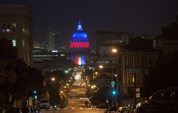 San Francisco's City Hall is illuminated in blue, white and red on November 14, 2015, one day after the Paris terrorist attac