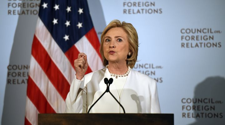 Democratic presidential hopeful Hillary Clinton describesher strategy for defeating the Islamic State group in the wake
