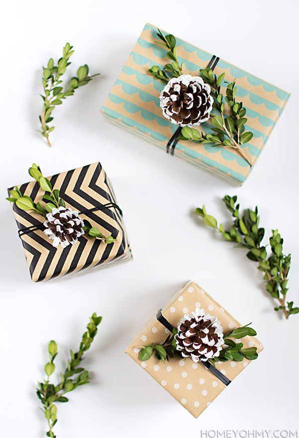 "Make gift wrapping fun this year and DIY these adorable boxwood and pinecone toppers. Follow the tutorial on <a href=""http://"