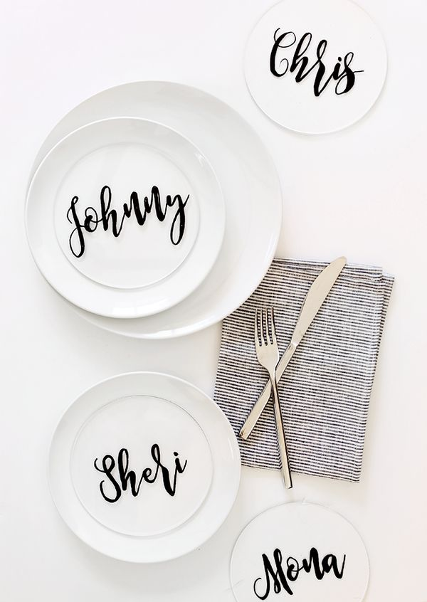 "These place cards from <a href=""http://www.almostmakesperfect.com/2015/11/18/diy-plexiglass-calligraphy-place-cards/"" target="