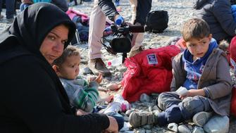 GEVGELIJA, MACEDONIA - NOVEMBER 19: Syrian refugees wait at the refugee camp in Gevgelija, Macedonia on November 19, 2015. (Photo by Besar Ademi/Anadolu Agency/Getty Images)