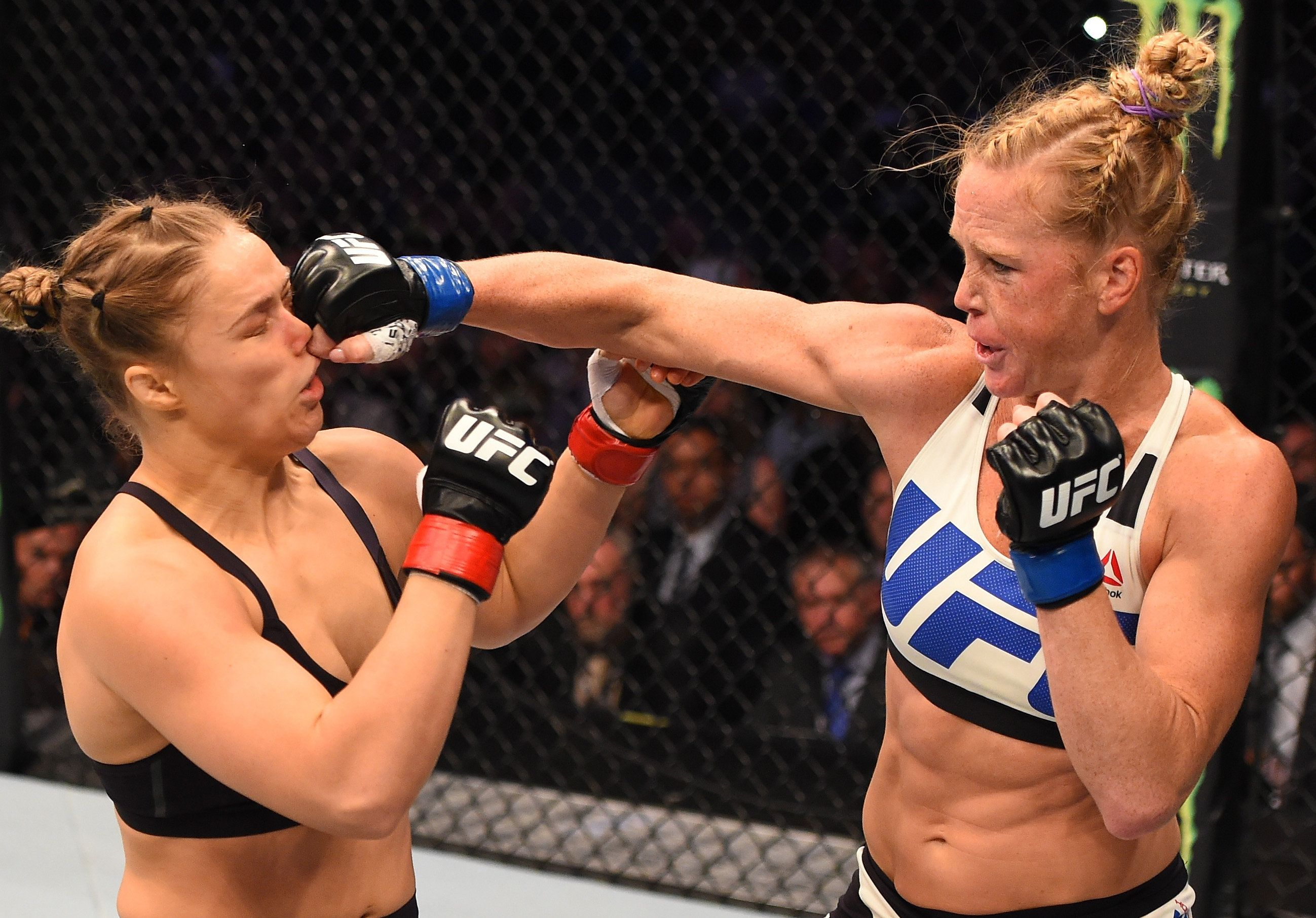 Holm punches Rousey in their UFC women's bantamweight championship bout in Melbourne, Australia.
