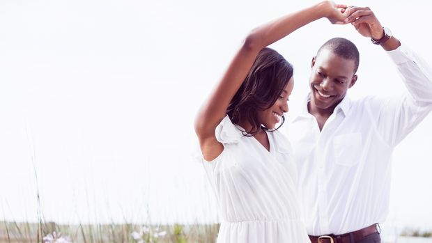 Romantic couple dancing and smiling