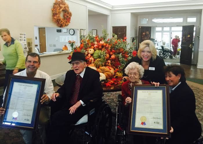 Allan and Margaret Little receiving a state proclamation in honor of their 100th birthdays.
