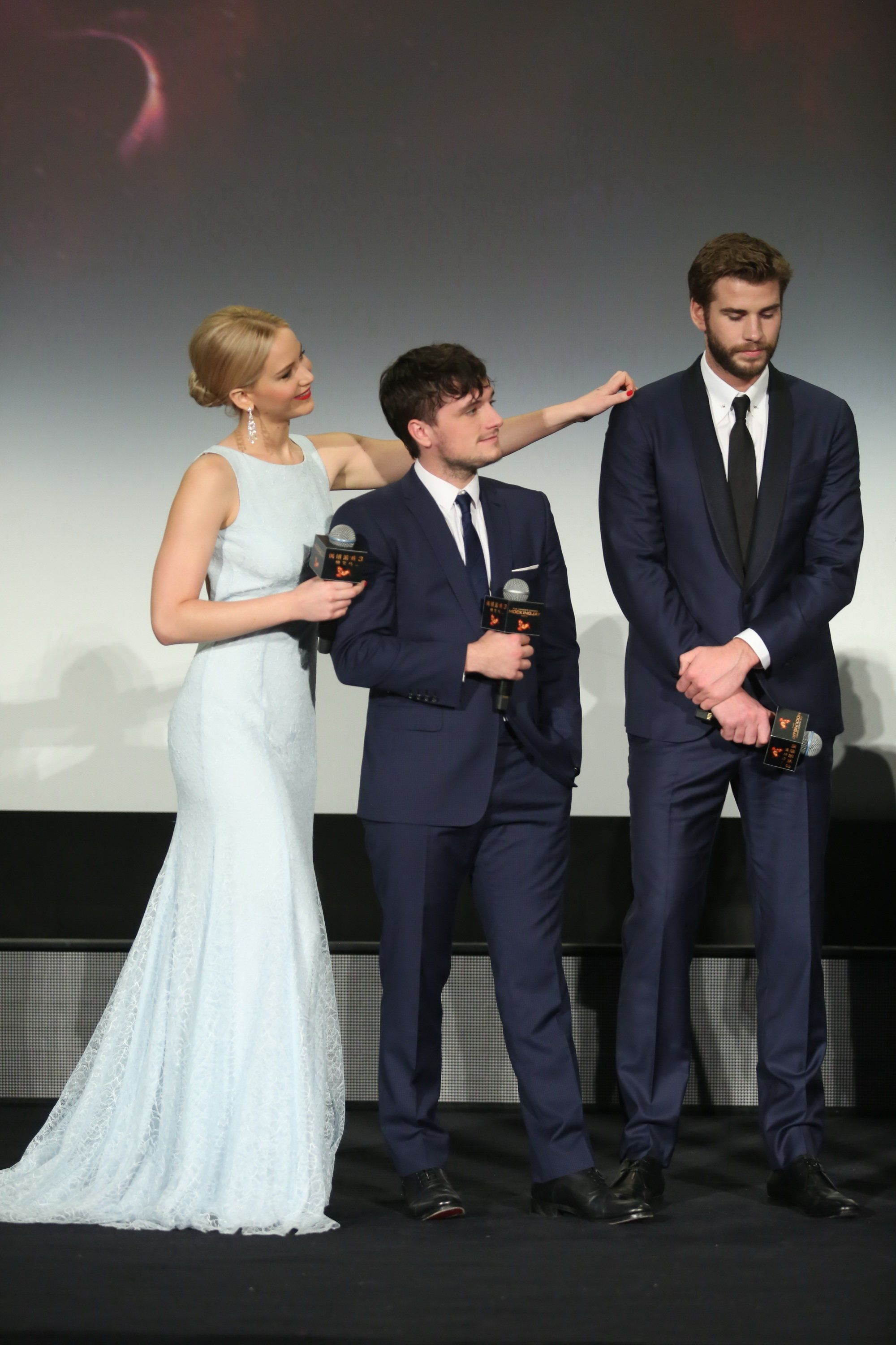 BEIJING, CHINA - NOVEMBER 12:  (CHINA OUT) (L - R) Actress Jennifer Lawrence, actor Josh Hutcherson and actor Liam Hemsworth attend 'Los Juegos Del Hambre: Sinsajo - Part 2' premiere at the Solana on November 12, 2015 in Beijing, China.  (Photo by ChinaFotoPress/ChinaFotoPress via Getty Images)
