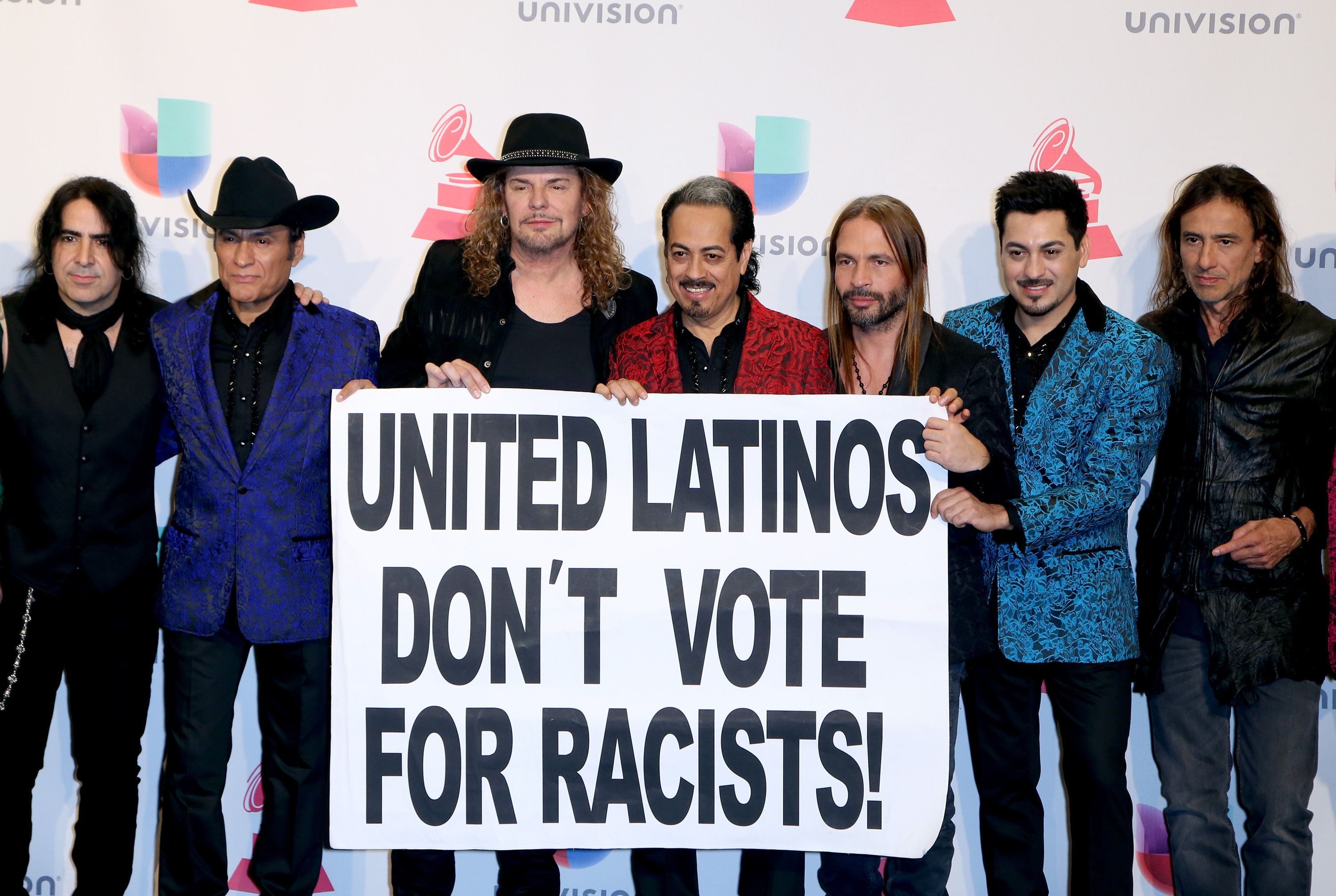 LAS VEGAS, NV - NOVEMBER 19:  Members of the music groups Mana and Los Tigres Del Norte hold up a sign as they pose in the press room during the 16th Latin GRAMMY Awards at the MGM Grand Garden Arena on November 19, 2015 in Las Vegas, Nevada.  (Photo by Gabe Ginsberg/WireImage)