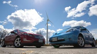 The Chevrolet Volt (left) and Nissan Leaf (right) are photographed in Toronto on April 11, 2012. Toronto Star / Pawel Dwulit (Photo by Pawel Dwulit/Toronto Star via Getty Images)