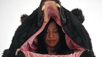 "Eiko Ishizawa inside of her ""Great Sleeping Bear."""
