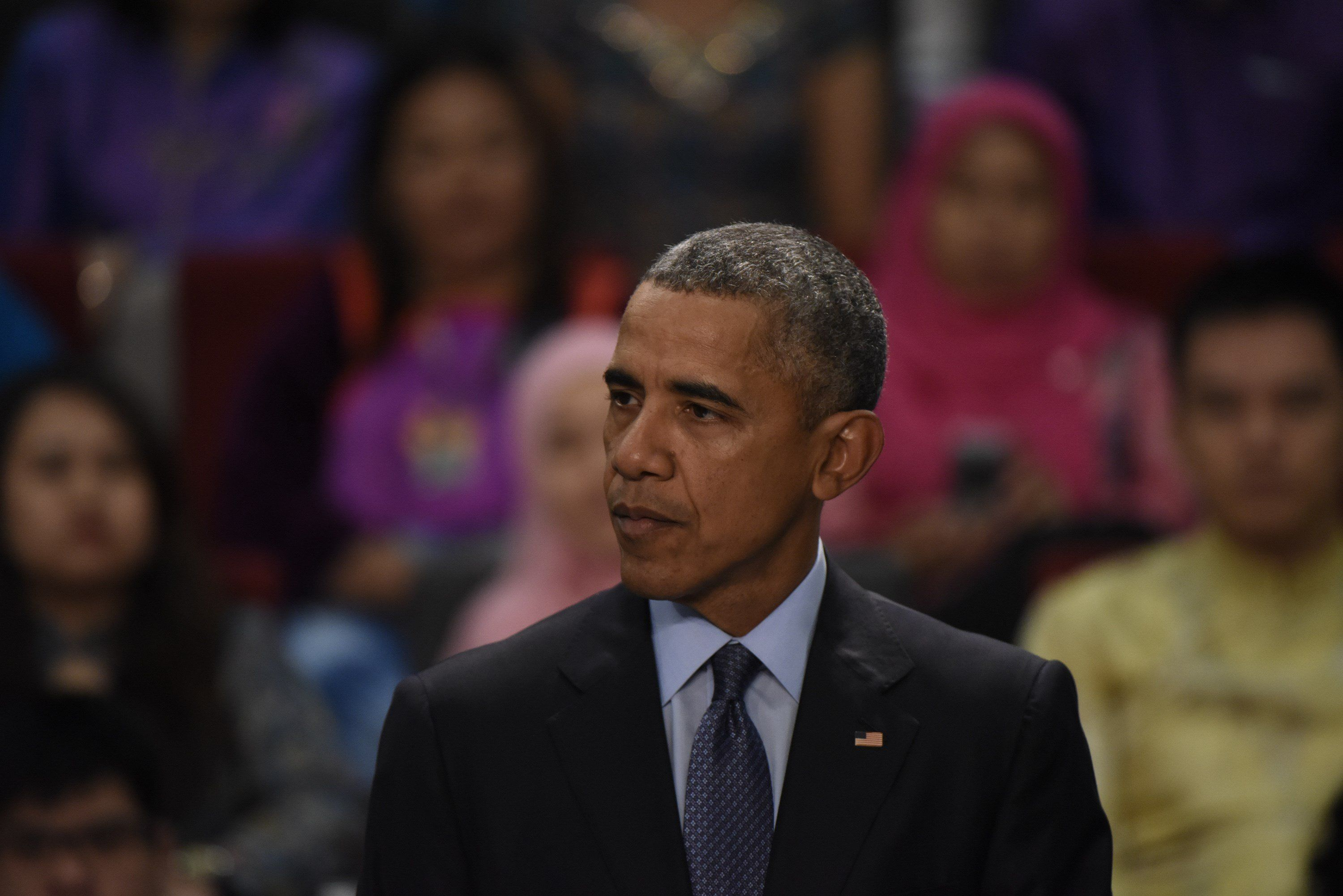US President Barack Obama answers a question during a town hall with Young Southeast Asia Leaders Initiative (YSEALI) at Taylor's University in Kuala Lumpur on November 20, 2015. US President Barack Obama arrived in Malaysia to attend the 27th Association of South East Asian Nations (ASEAN) Summit being held from November 18-22. AFP PHOTO / FRED DUFOUR        (Photo credit should read FRED DUFOUR,FRED DEFOUR/AFP/Getty Images)