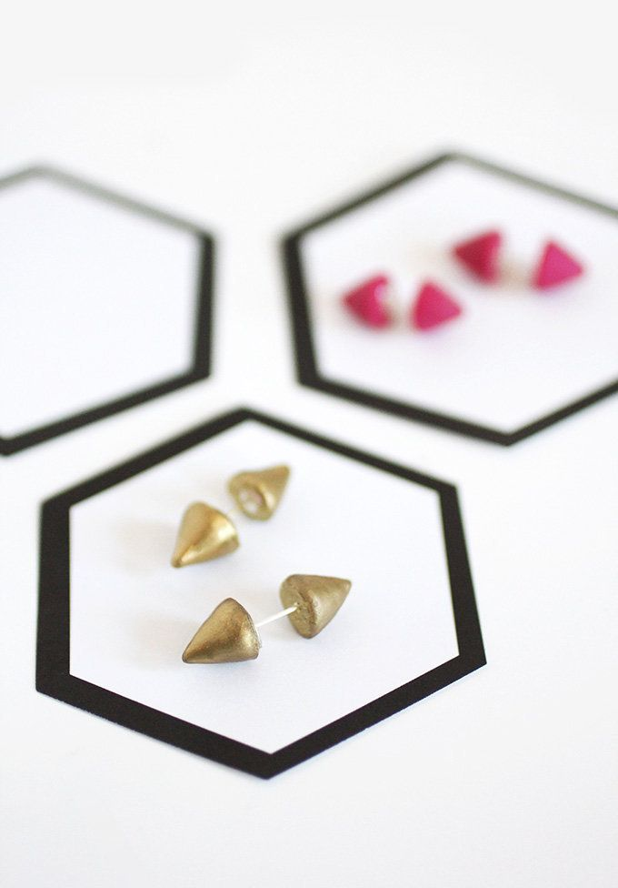 """For the glam girl in your life, head over to <a href=""""http://ispydiy.com/my-diy-double-sided-spiked-earrings/"""" target=""""_blank"""
