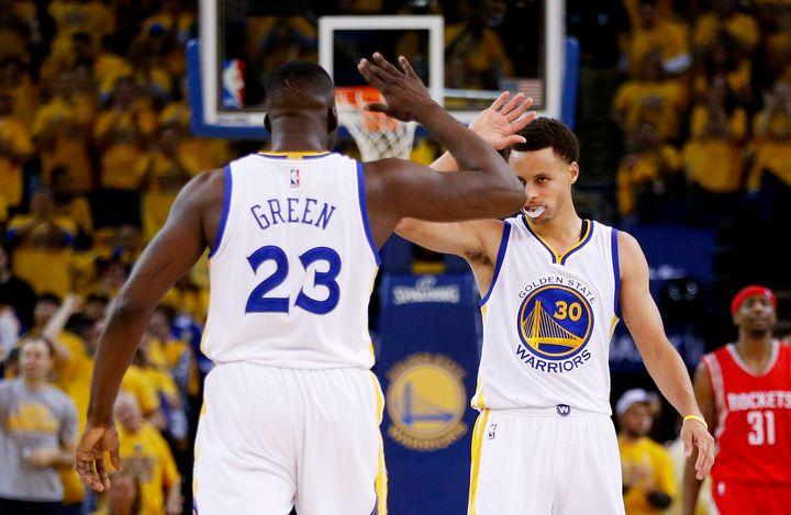 Point forward Draymond Green and reigning league MVP Stephen Curry (right) are both enjoying stellar seasons thus far.