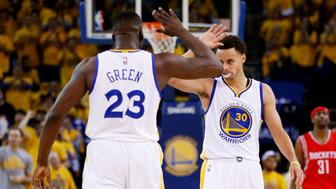 OAKLAND, CA - MAY 19:  Draymond Green #23 and Stephen Curry #30 of the Golden State Warriors celebrate in the second quarter against the Houston Rockets during Game One of the Western Conference Finals of the 2015 NBA Playoffs at ORACLE Arena on May 19, 2015 in Oakland, California.  NOTE TO USER: User expressly acknowledges and agrees that, by downloading and or using this photograph, user is consenting to the terms and conditions of Getty Images License Agreement. (Photo by Ezra Shaw/Getty Images)