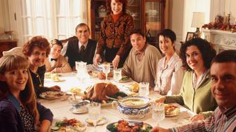 Three generation family sitting aroungc dining table, portrait