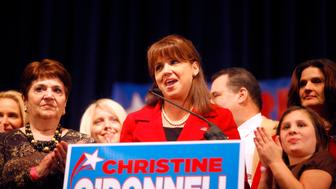 DOVER, DE - NOVEMBER 2:  Republican U.S. Senate candidate Christine O'Donnell speaks to her supporters after losing the midterm election to Democratic nominee U.S. Senator-elect Chris Coons (D-DE) on November 2, 2010 in Dover, Delaware. Coons will take over Vice President Joe Biden's old U.S. Senate seat. (Photo by Jessica Kourkounis/Getty Images)
