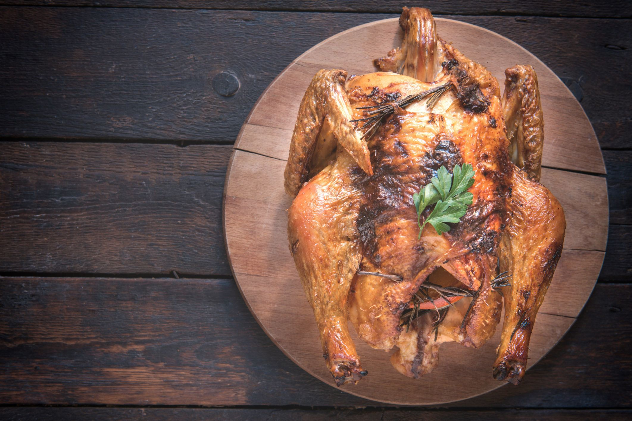 Split toasted turkey on the wooden background with blank space