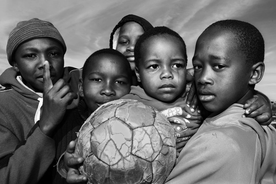 Photograph of children in the town of Gugulethu, the day after the World Cup semifinals in South Africa between Hol