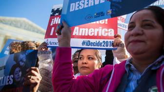 UNITED STATES - NOVEMBER 20 - Protestors gather in front of the Supreme Court in support of President Barack Obama's policy to temporarily protect up to five million unauthorized immigrants from deportation, also known as the keep families together rally, in Washington, Friday, November 20, 2015. (Photo By Al Drago/CQ Roll Call)