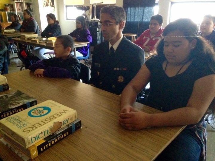 U.S. Surgeon General Vivek Murthy meditates with students in San Francisco, Calif.