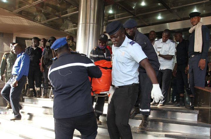 Officers evacuate bodies of victims from the Radisson Blu hotel in Bamako on November 20, 2015, after the assault of security