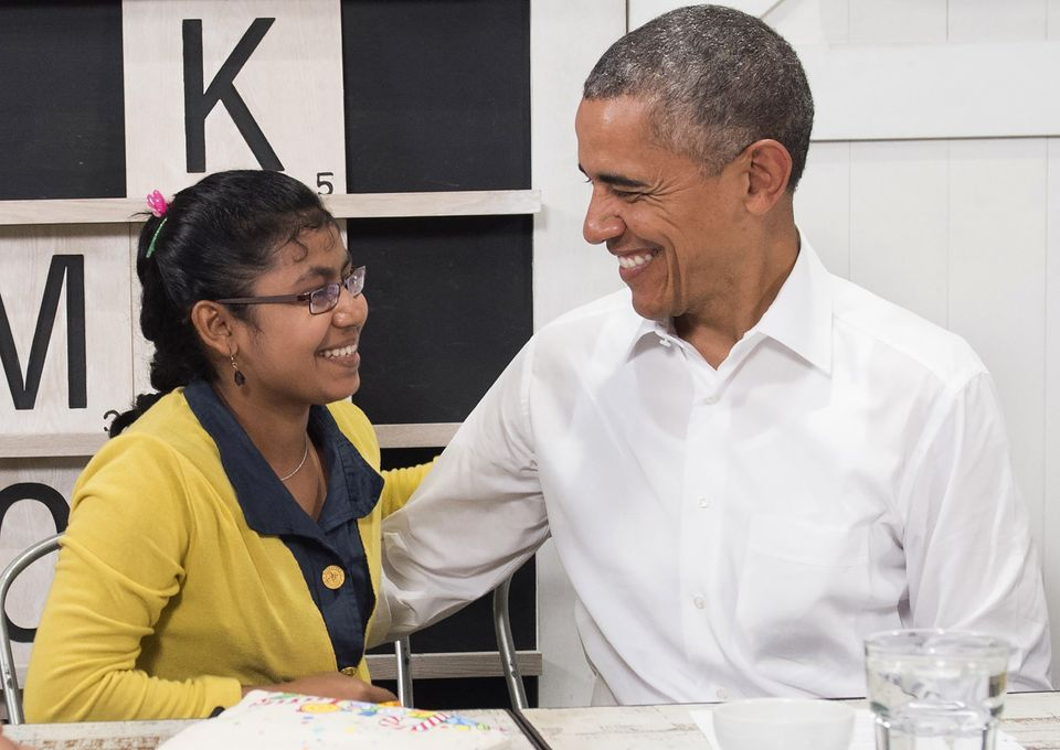 President Obama smiles with a 16-year-old refugee girl from Myanmar that was subjected to human trafficking and will now be m