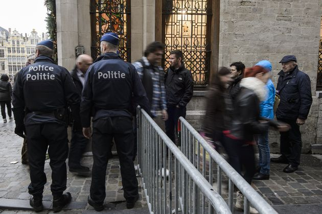 Police check people entering the Brussels Grand Place on November 20, 2015. Belgium's national security...