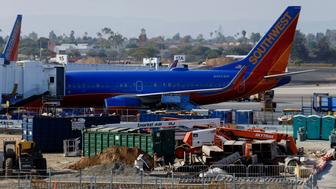 A Southwest Airlines Boeing Co. 737 plane stands at the gate next to a construction site during renovations of Terminal 1 at Los Angeles International Airport (LAX) in Los Angeles, California, U.S., on Tuesday, Aug. 18, 2015. LAX is one of a handful of major U.S. airports where no one carrier dominates -- each of the four biggest airlines now holds market share between 14 percent and 18 percent. Photographer: Patrick T. Fallon/Bloomberg via Getty Images