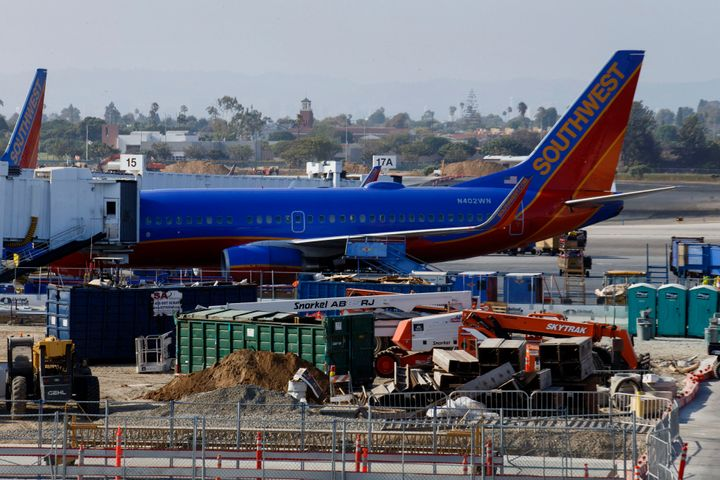 Two men were reportedly blocked from boarding a Southwest flight after another passenger overheard them speaking Arabic and s
