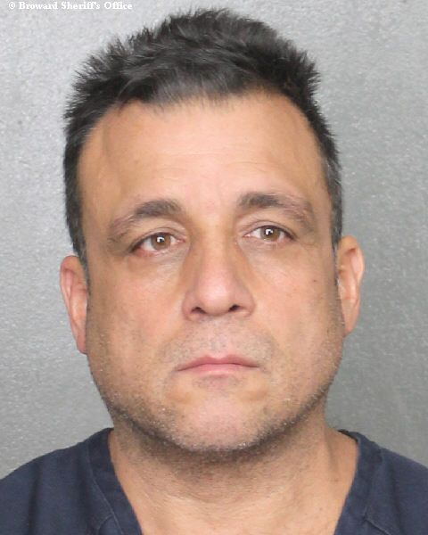 Andres Zamora, 51, is accused of selling drugs and stolen guns from his south Florida home while also illegally cashing in on