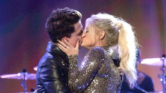 LOS ANGELES, CA - NOVEMBER 22: Singers Charlie Puth (L) and Meghan Trainor kiss onstage  during the 2015 American Music Awards at Microsoft Theater on November 22, 2015 in Los Angeles, California.  (Photo by Jeff Kravitz/AMA2015/FilmMagic)