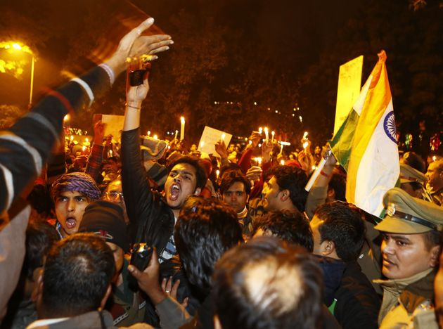 Protesters shout slogans during a rally in New Delhi on Dec.30, 2012, following the cremation of...