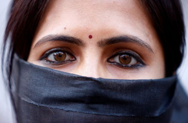 A womanat a silent protest on Dec.21, 2012, in Kolkata,
