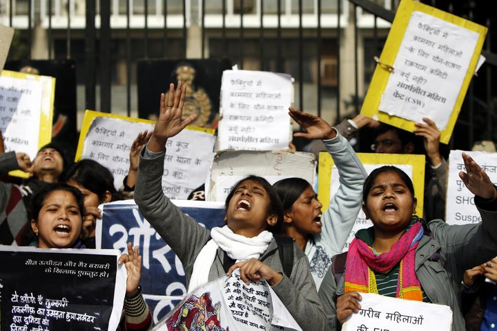 Protesters shout slogans during a demonstration outside police headquarters in New Delhi on Jan. 13, 2015. The protester