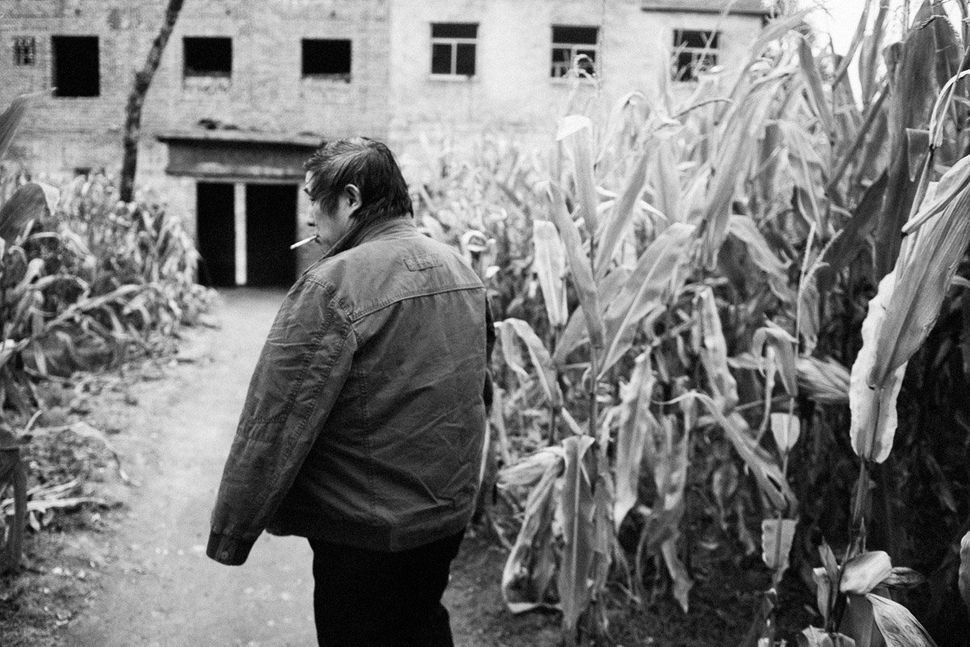 Liu Renwang in his courtyard in Yaoyu Village, China.