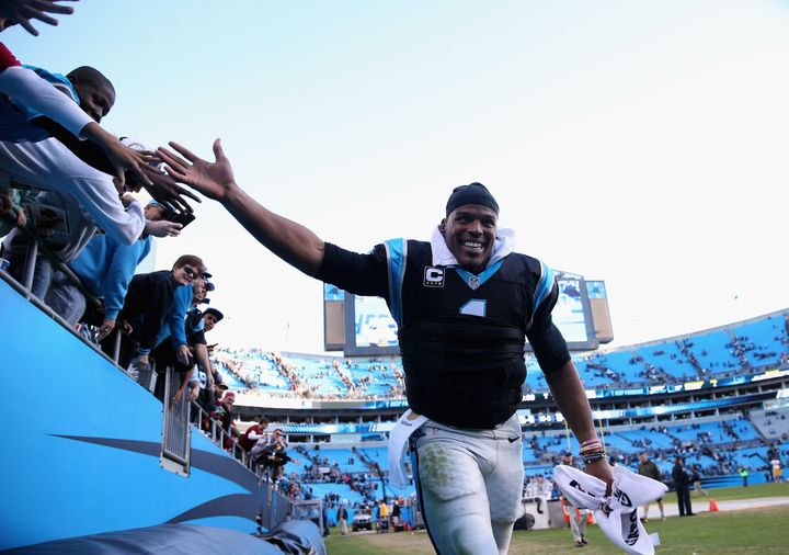 Newton celebrates with fans after defeating the Washington Redskins on Nov.22, 2015, in Charlotte, North Carolina.