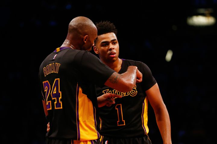 Kobe Bryant talks strategy with rookie point guard D'Angelo Russell during their game against theBrooklyn Nets on Nov.