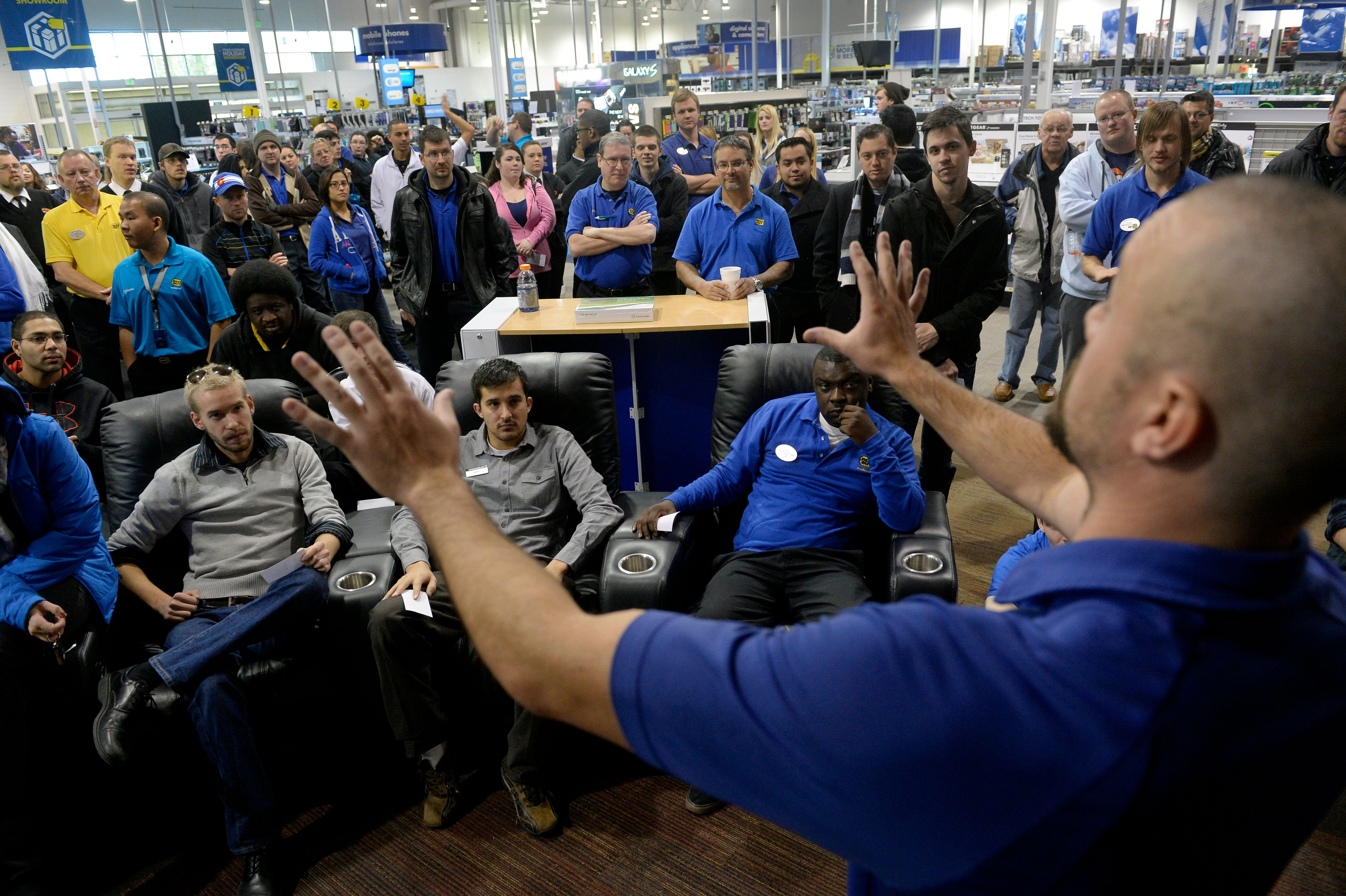 DENVER, CO. - NOVEMBER 23: General Manager Doug Ryan, right, prepares his staff for a Black Friday rehearsal at Best Buy in Denver, CO November 23, 2013. Employees practiced Black Friday scenarios, managing crowds and organizing lines. Sales Manager Kevin Ribbens said it is especially useful for employees that have never worked on the busiest shopping day of the year.  (Photo By Craig F. Walker / The Denver Post)