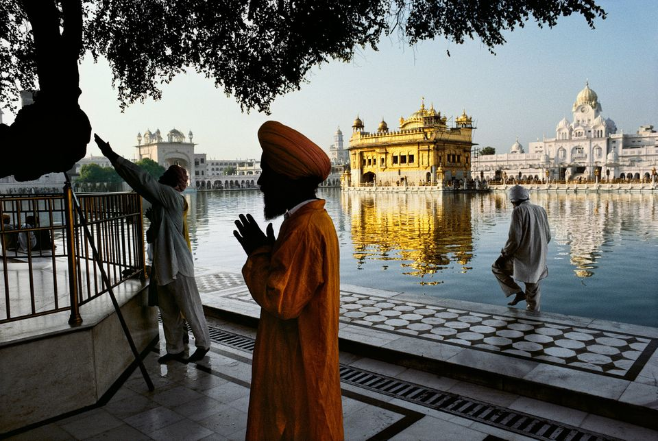Sikh devotee prays at the Golden Temple, Amritsar, Punjab; 1996<i> </i>