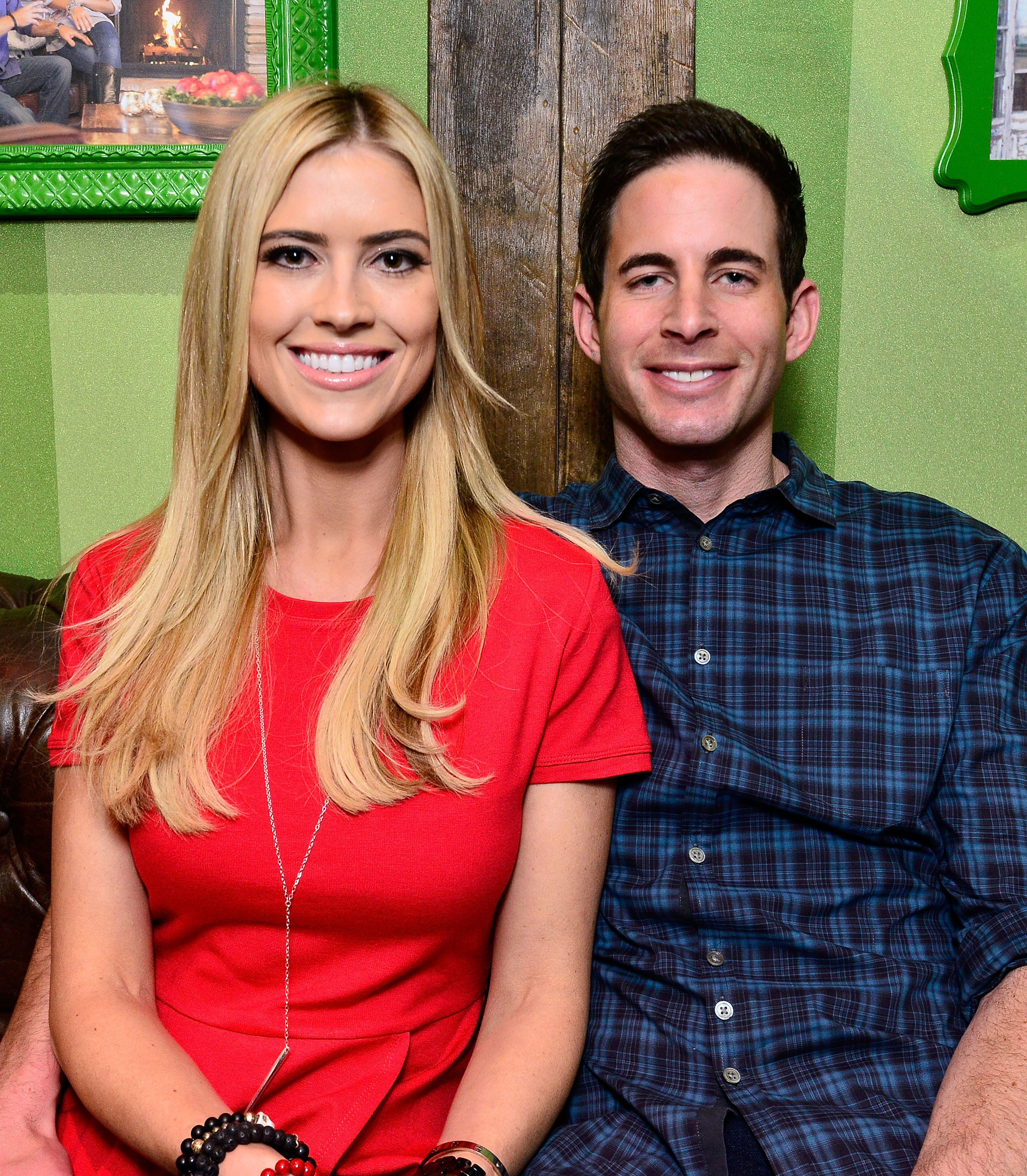 LAKEWOOD, CA - DECEMBER 13:  Tarek and Christina El Moussa, hosts of HGTV's hit show Flip or Flop, visited the HGTV Santa HQ at Lakewood Center. The reality stars visited with Santa, toured the new digital Santa headquarters and celebrated the holidays with fans on December 13, 2014 in Lakewood, California.  (Photo by Jerod Harris/Getty Images for Lakewood Center)