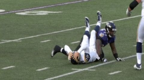 Rams quarterback Case Keenum grabs his head after being concussed against the Baltimore Ravens.