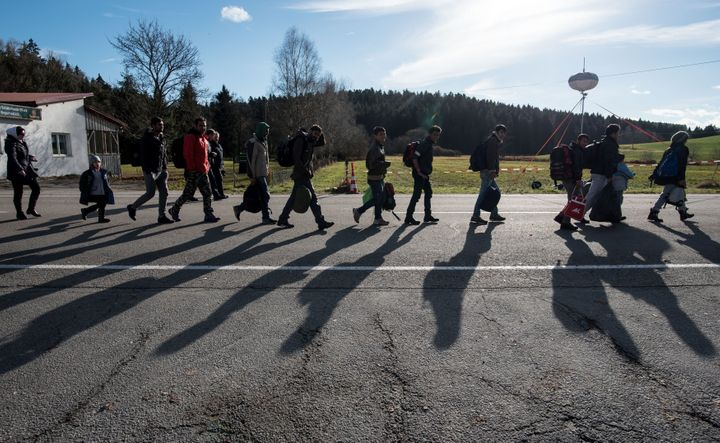Refugees cross the Austrian-German border in Wegscheid, Germany, on Nov. 18, 2015. Reuters reported in Oct. that roughly 10,0