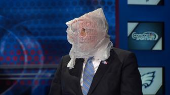 Former Pennsylvania Gov. Ed Rendell wears a bag on his head after a disappointing Eagles loss.