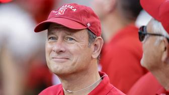 U.S. Chief Justice John Roberts visits the sidelines before an NCAA college football game between Nebraska and Miami in Lincoln, Neb., Saturday, Sept. 20, 2014. (AP Photo/Nati Harnik)