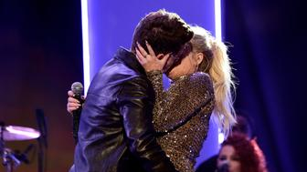LOS ANGELES, CA - NOVEMBER 22:  Singers Charlie Puth (L) and Meghan Trainor kiss onstage during the 2015 American Music Awards at Microsoft Theater on November 22, 2015 in Los Angeles, California.  (Photo by Frazer Harrison/AMA2015/Getty Images for dcp)