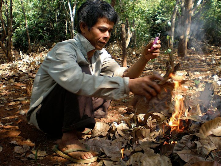 Ly Kamoun practicing slash-and-burn agriculture in his field, 2008.