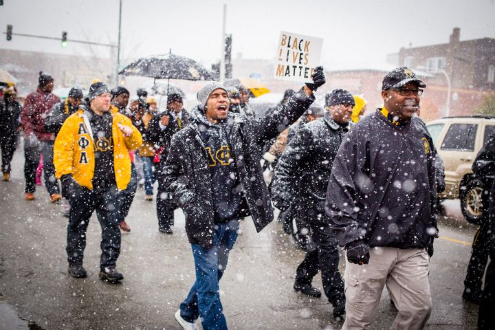 The Alpha Phi Alpha fraternity used the #AlphasInTheStreets to rally members from Indiana, Missouri and Illinois to protest v