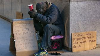 CHICAGO, IL - OCTOBER 10:  A homeless man begs for money in front of the Wrigley Building on October 10, 2015 in Chicago, Illinois. Chicago, the third largest city in the United States River, continues to draw millions of international and domesic tourists each year. (Photo by George Rose/Getty Images)