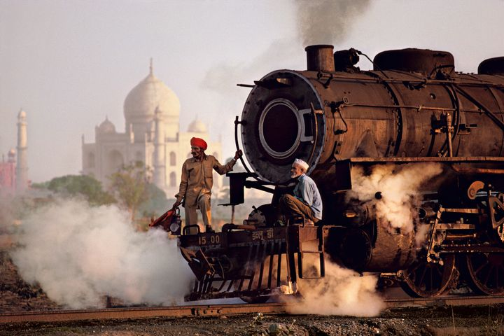 Steam engine passes in front of the Taj Mahal, Agra, Uttar Pradesh; 1983.