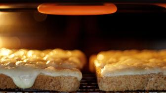 Creamy,Lancashire cheese on toast, under the grill.